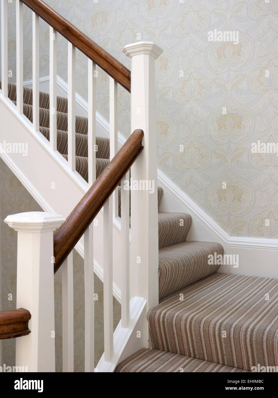 Brown and white banister on staircase, residential house ...