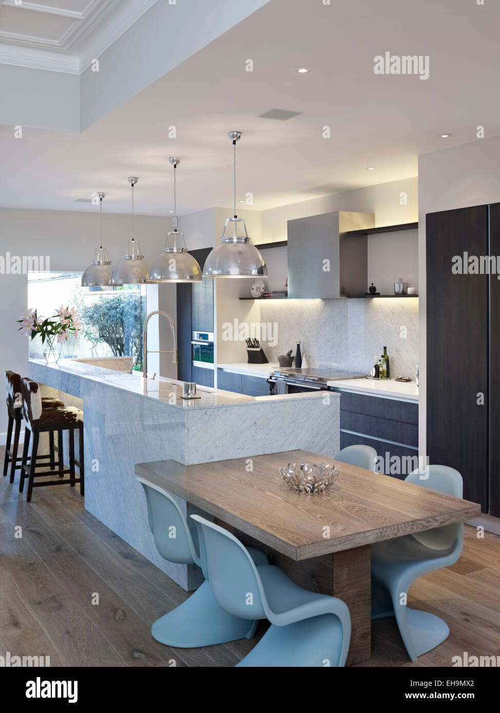 Kitchen Table And Breakfast Bar With Pendant Lamps In Large Open Plan Room,  Residential House, Thurleigh Road, Clapham, London, UK