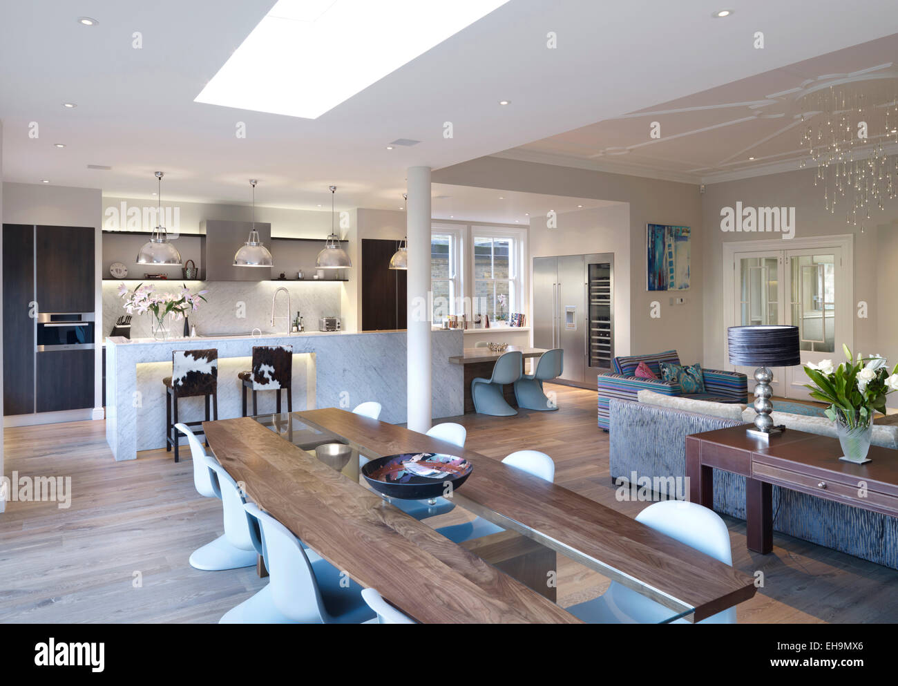 Dining table in large open plan room residential house Open plan house