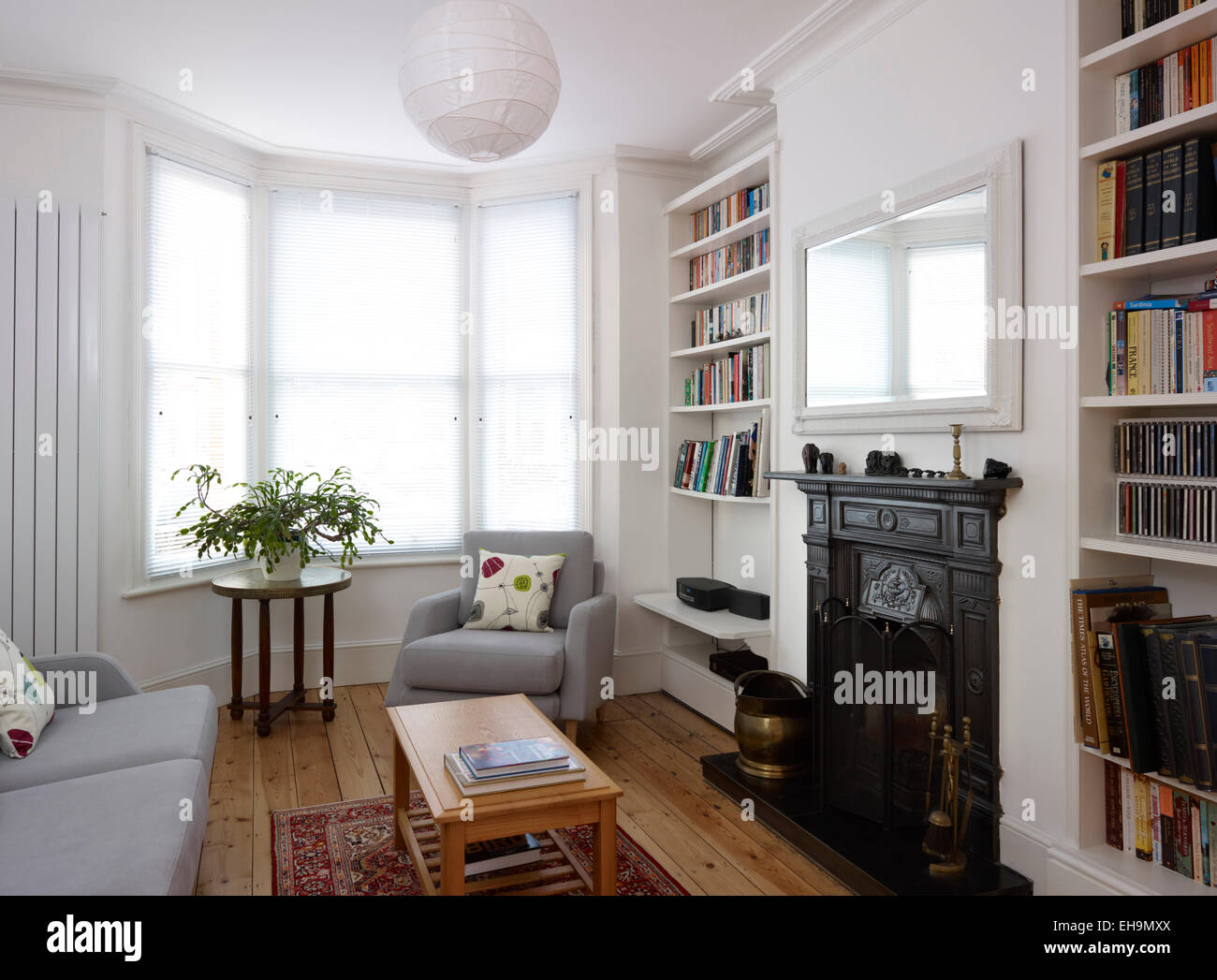 Sitting room with bay window and fireplace, residential house, UK ...