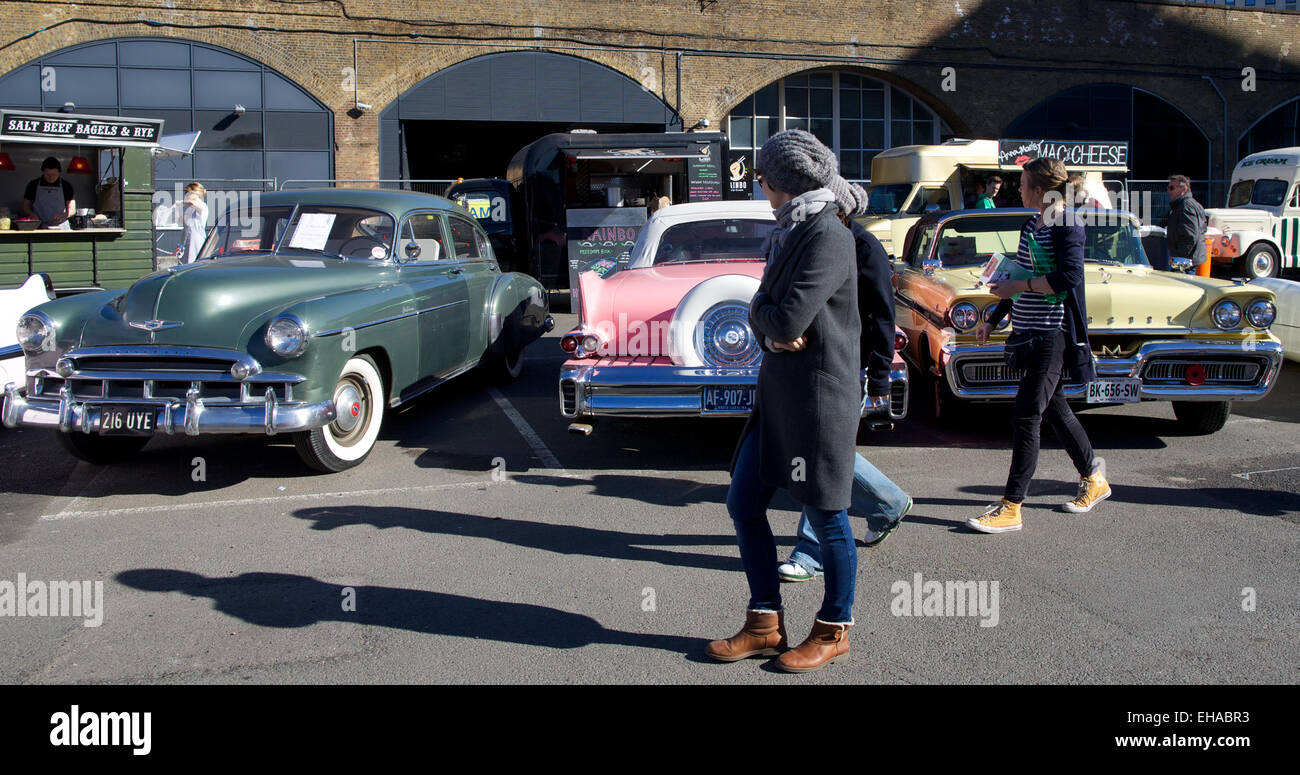 Stock photo united kingdom london people look at classic car parked at a classic car boot sale in the southbank in london on march 16 2014
