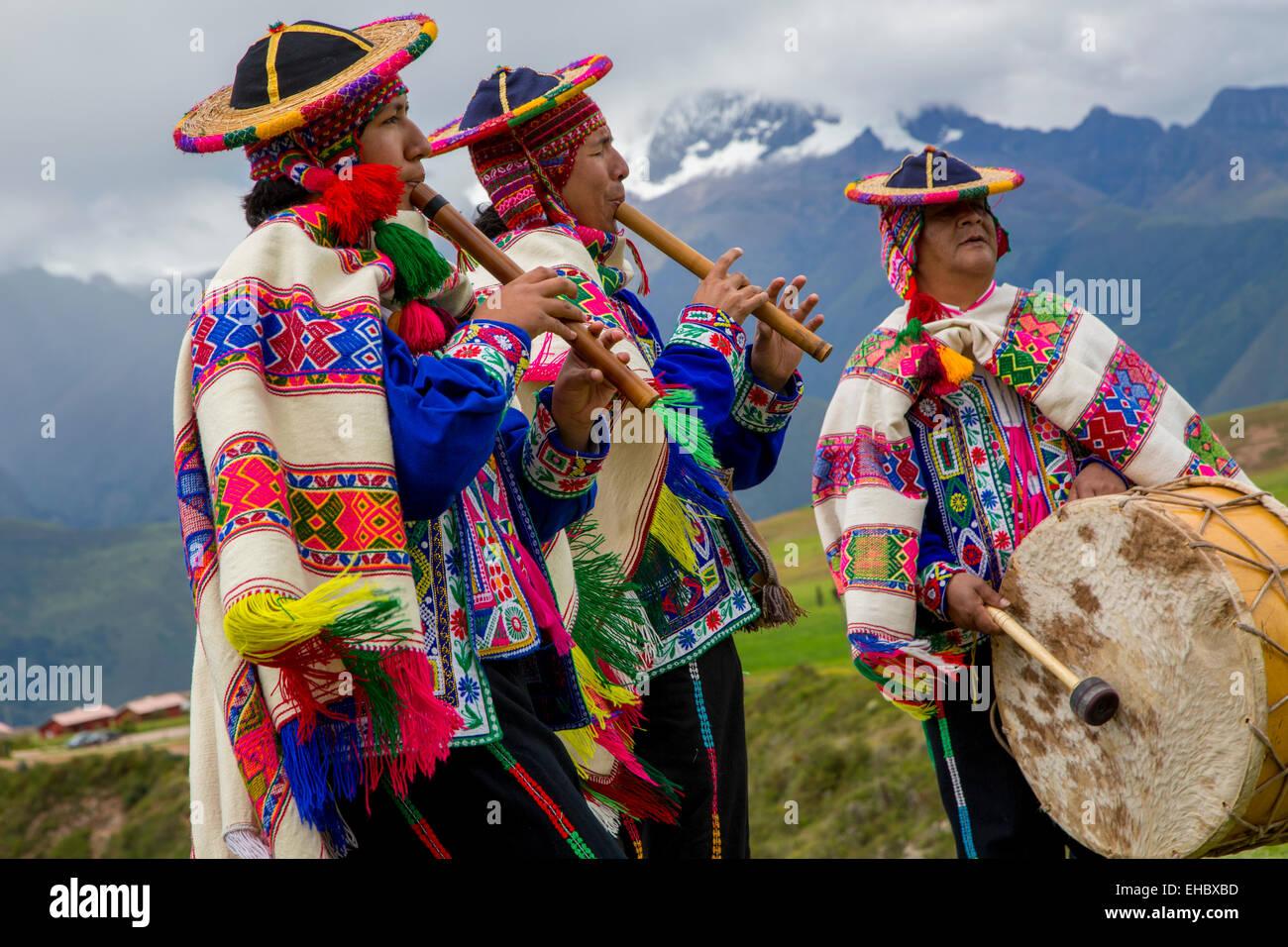 Stock Photo , Traditional Inca Dancers in costume, Inca terraces of Moray, Cusco Region, Urubamba Province, Machupicchu District, Peru