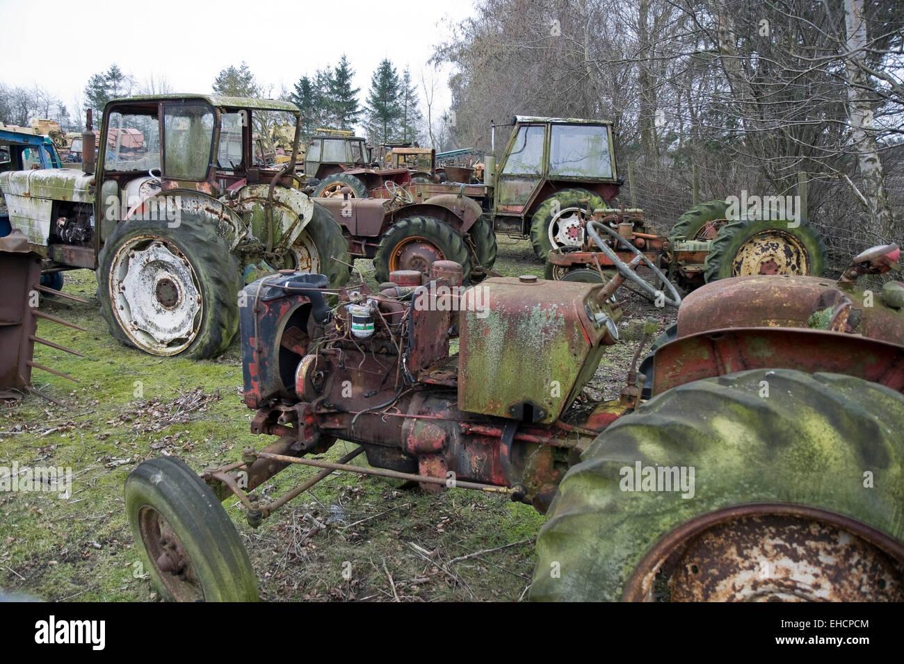 Old tractors on a scrap yard in jutland denmark stock for Scrap tractor tires