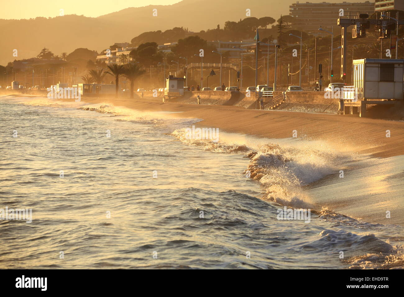 sunset above the beach of cannes la bocca stock photo royalty free image 79583751 alamy. Black Bedroom Furniture Sets. Home Design Ideas