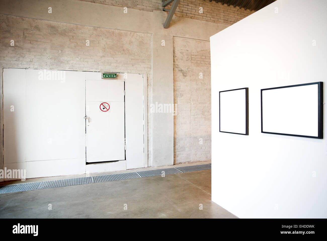 Two empty frames on white wall in museum Stock Photo, Royalty Free ...