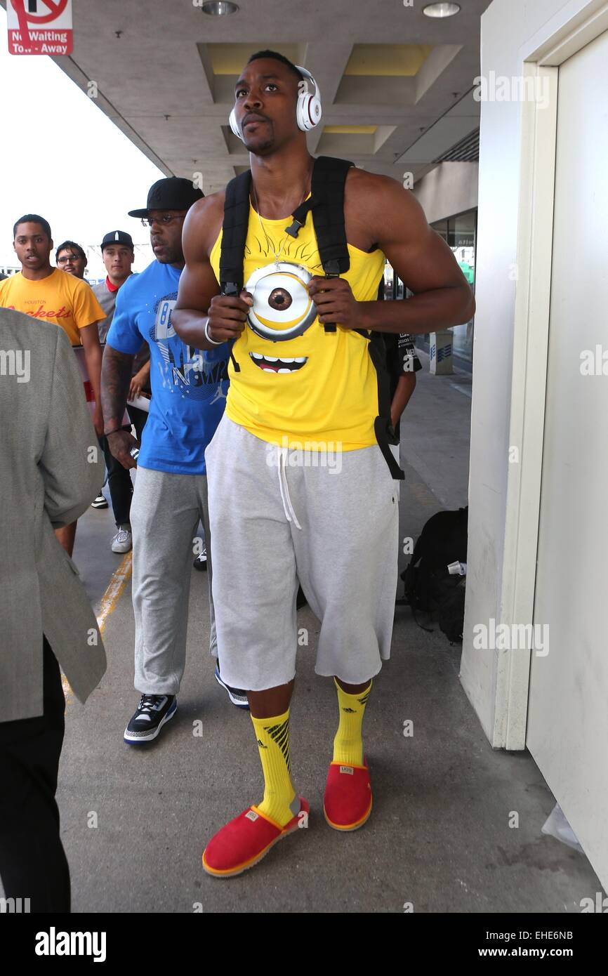 Dwight Howard, wearing a Ugg red slippers and a minion top ...