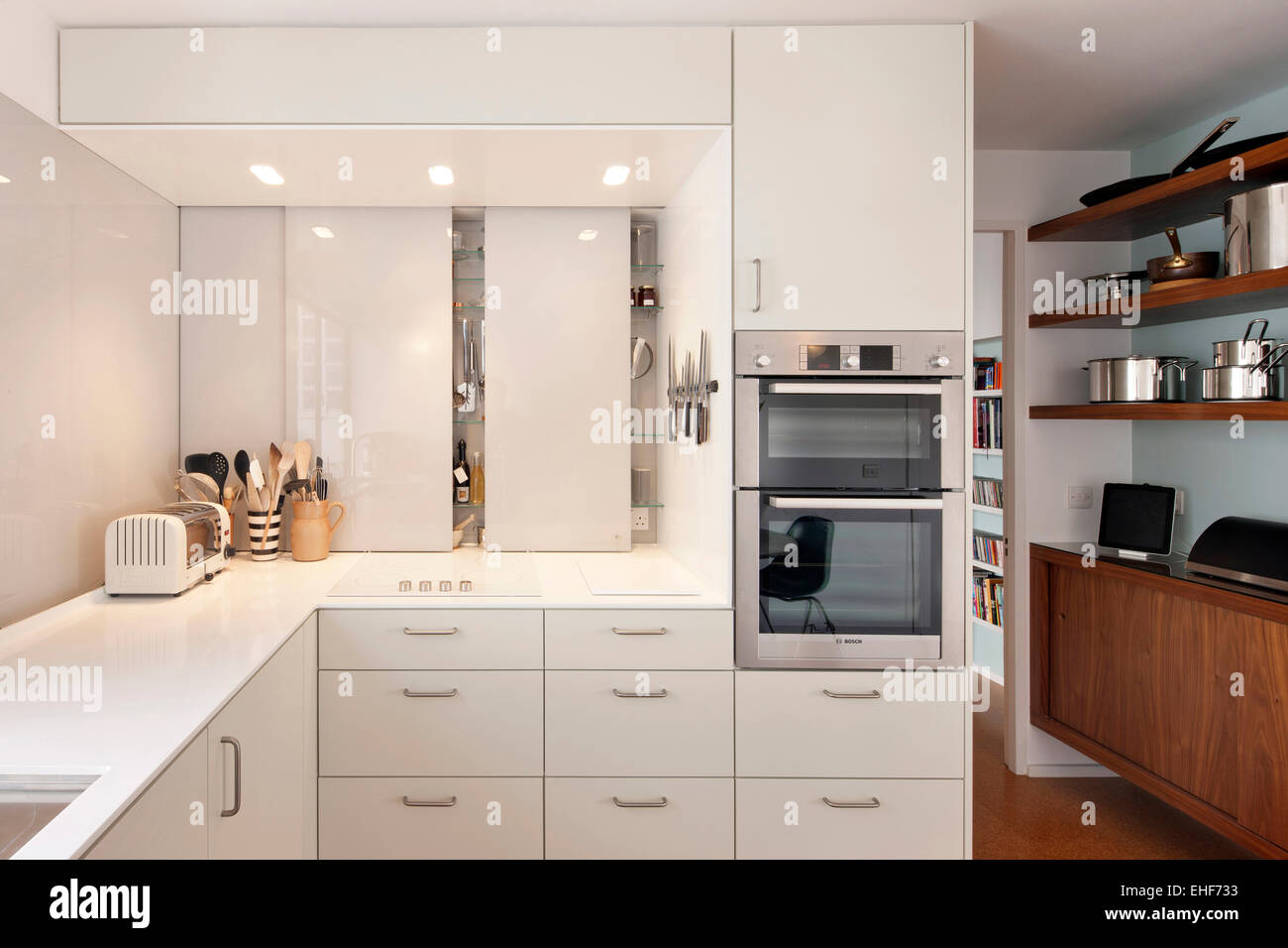 modern kitchen with white units in apartment in highpoint one london