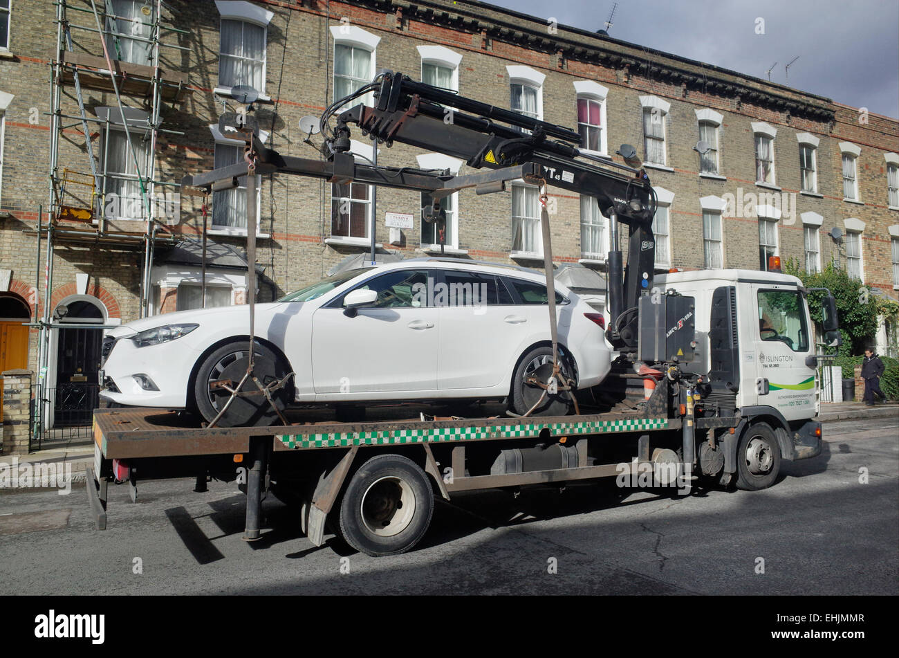 car being towed away on a flat bed truck by local council enforcement stock photo royalty free. Black Bedroom Furniture Sets. Home Design Ideas