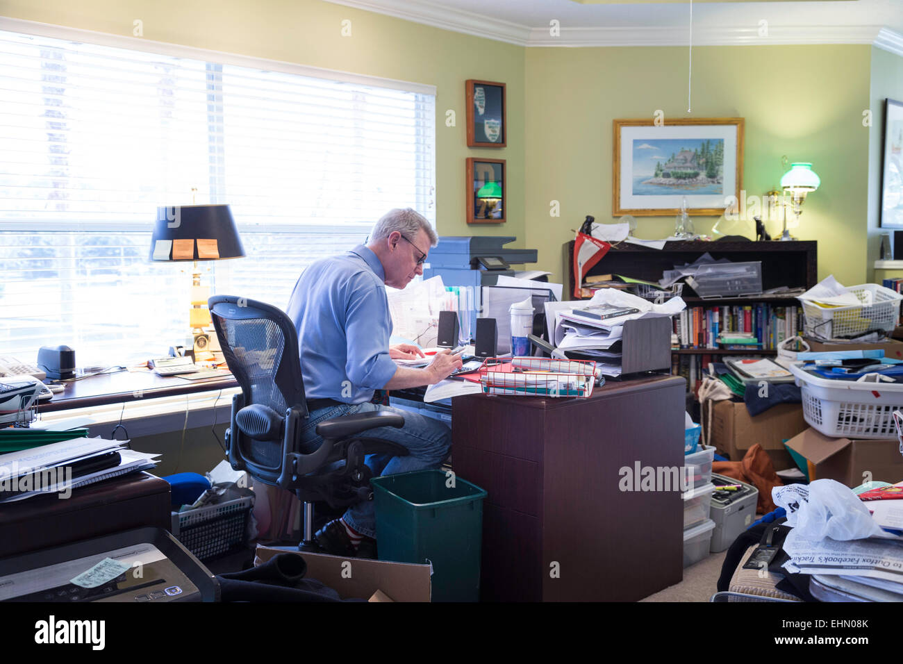 Businessman in Messy Home Office USA Stock Photo Royalty Free