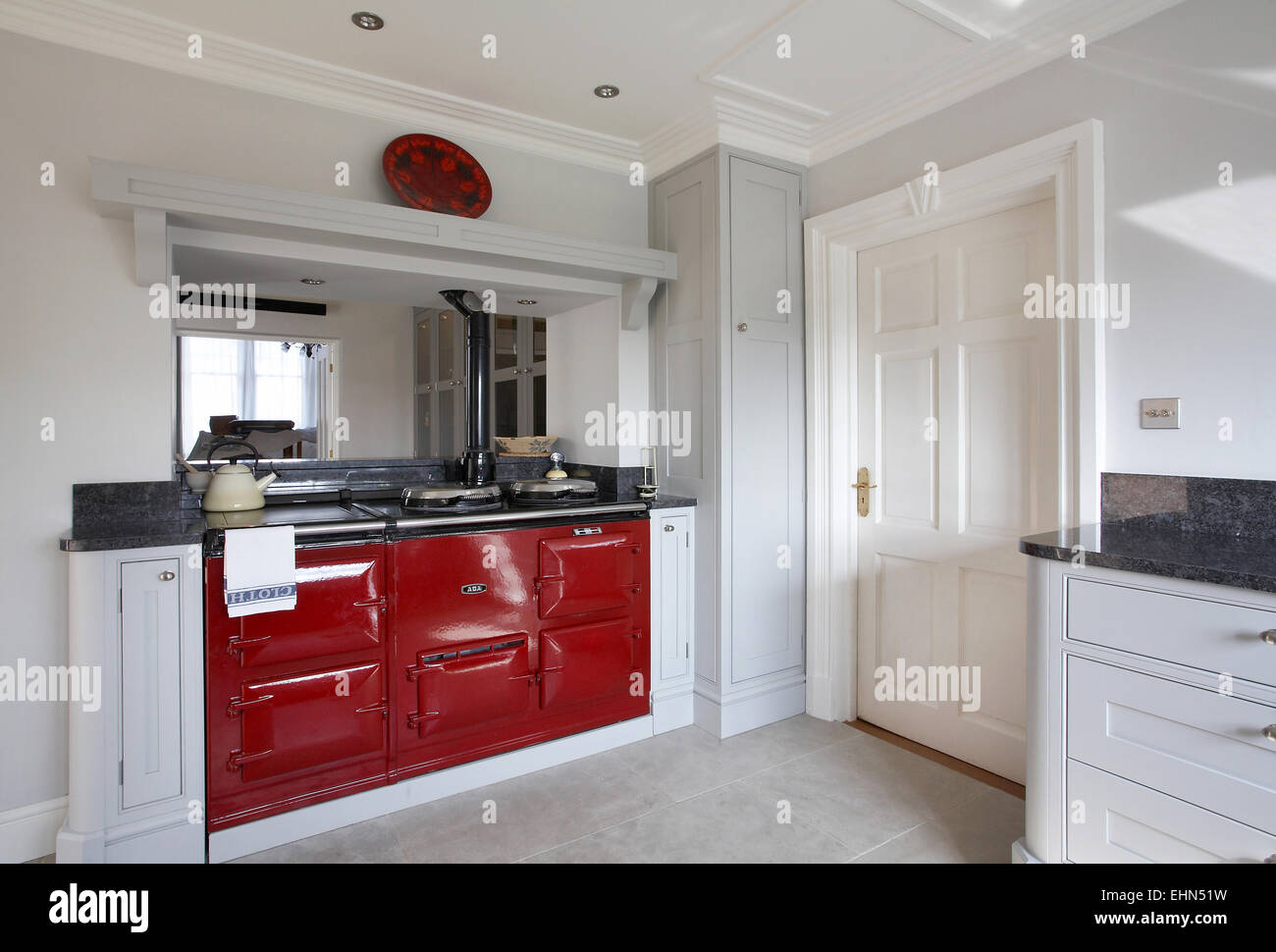 A red aga cooker in a modern kitchen in a home in the uk for Modern kitchen design with aga