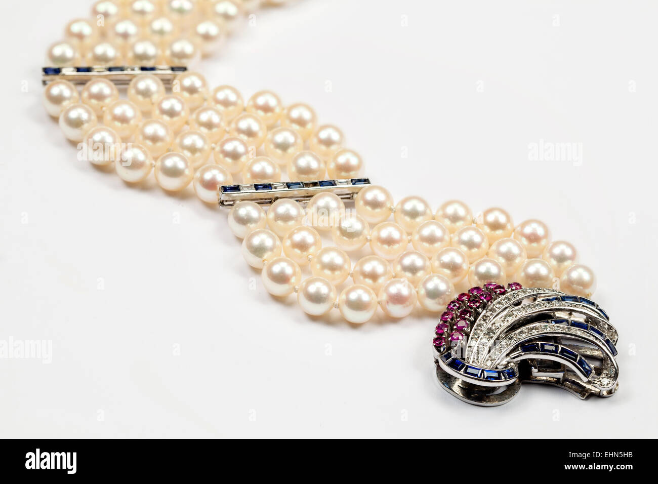 A Multistrand Pearl Bracelet With Diamond, Ruby And Sapphire Clasp