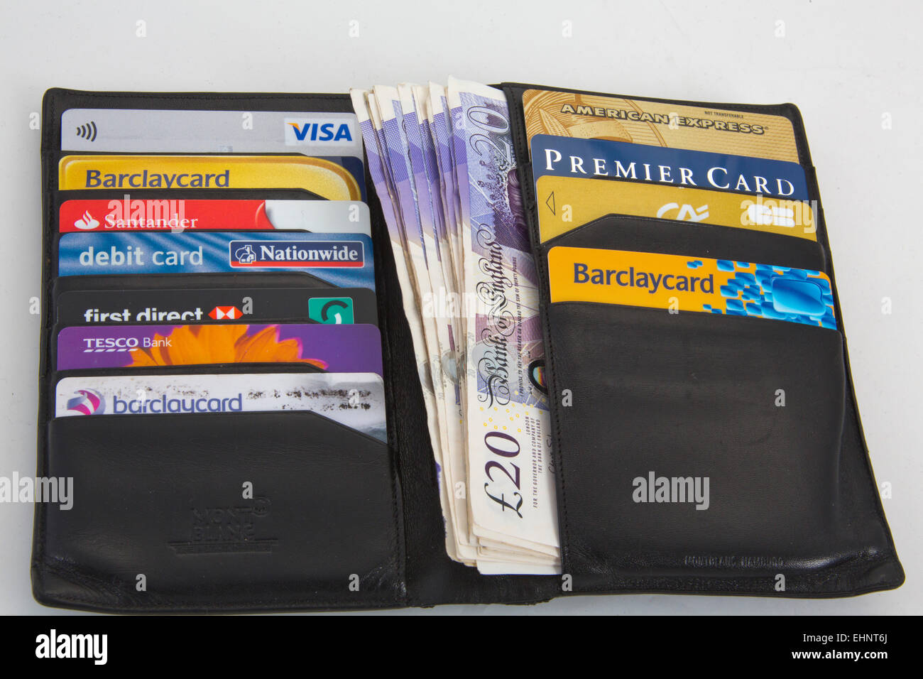 Black Wallet With Assortment Of Credit Cards Visa And