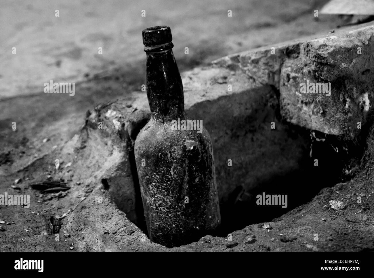 Vintage Bottle In A Hole