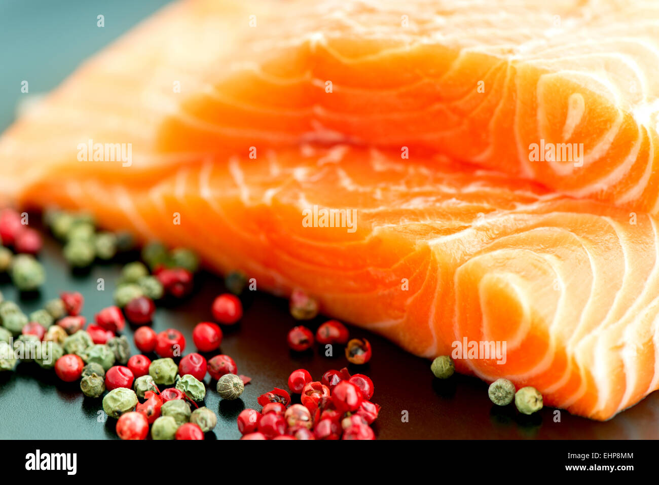 Raw Salmon Ready To Cook Close Up On Black Surface