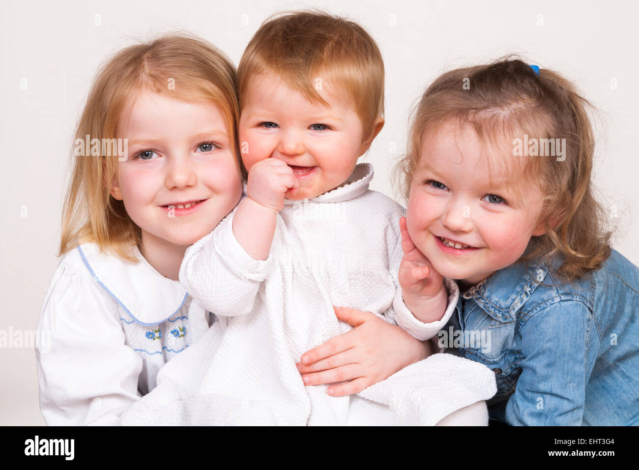 family-group-portrait-of-3-three-young-c