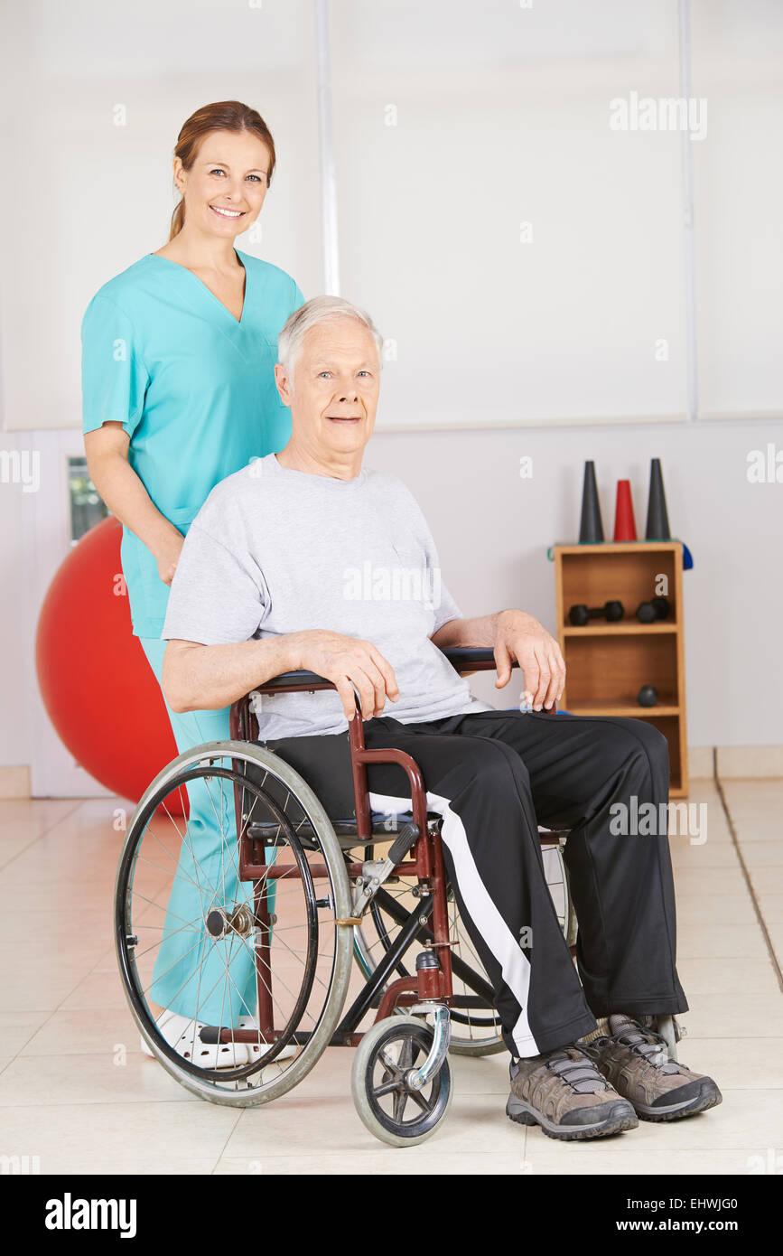 Man In Wheel Chair - Old man in wheelchair with geriatic nurse in a nursing home