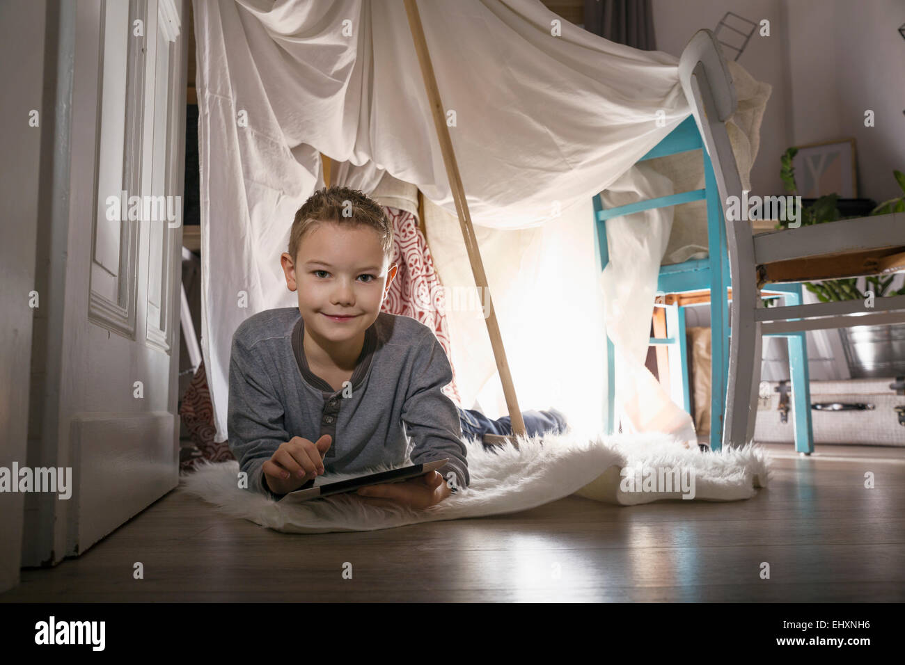 Boy digital tablet lying in self-made tent at home in the evening  sc 1 st  Alamy & Boy digital tablet lying in self-made tent at home in the evening ...