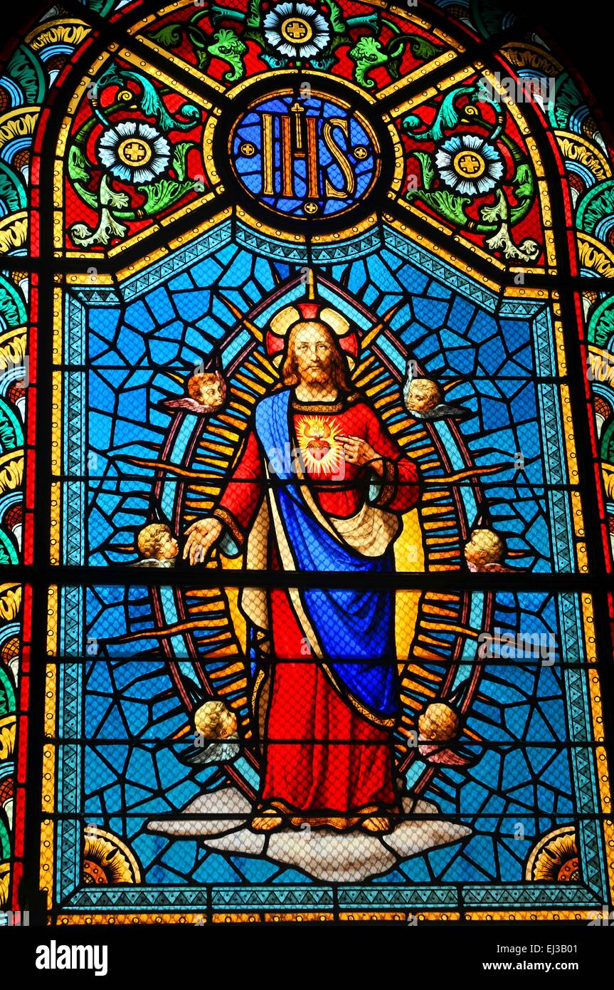 Stained Glass Window Depicting Sacred Heart Of Jesus In Medieval Church