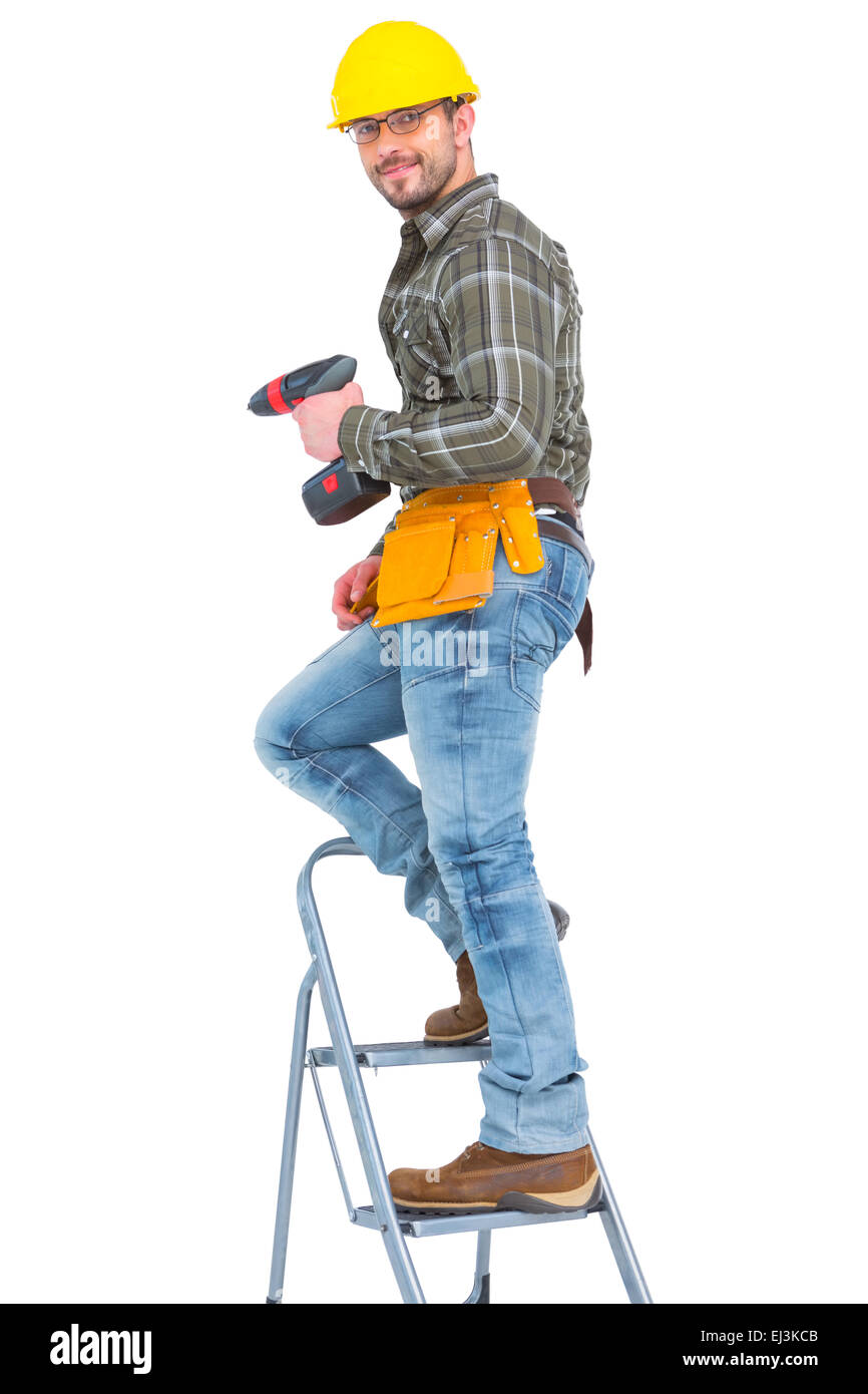 Repairman with drill machine climbing ladder Stock Photo, Royalty ... for Worker Climbing Ladder  155fiz