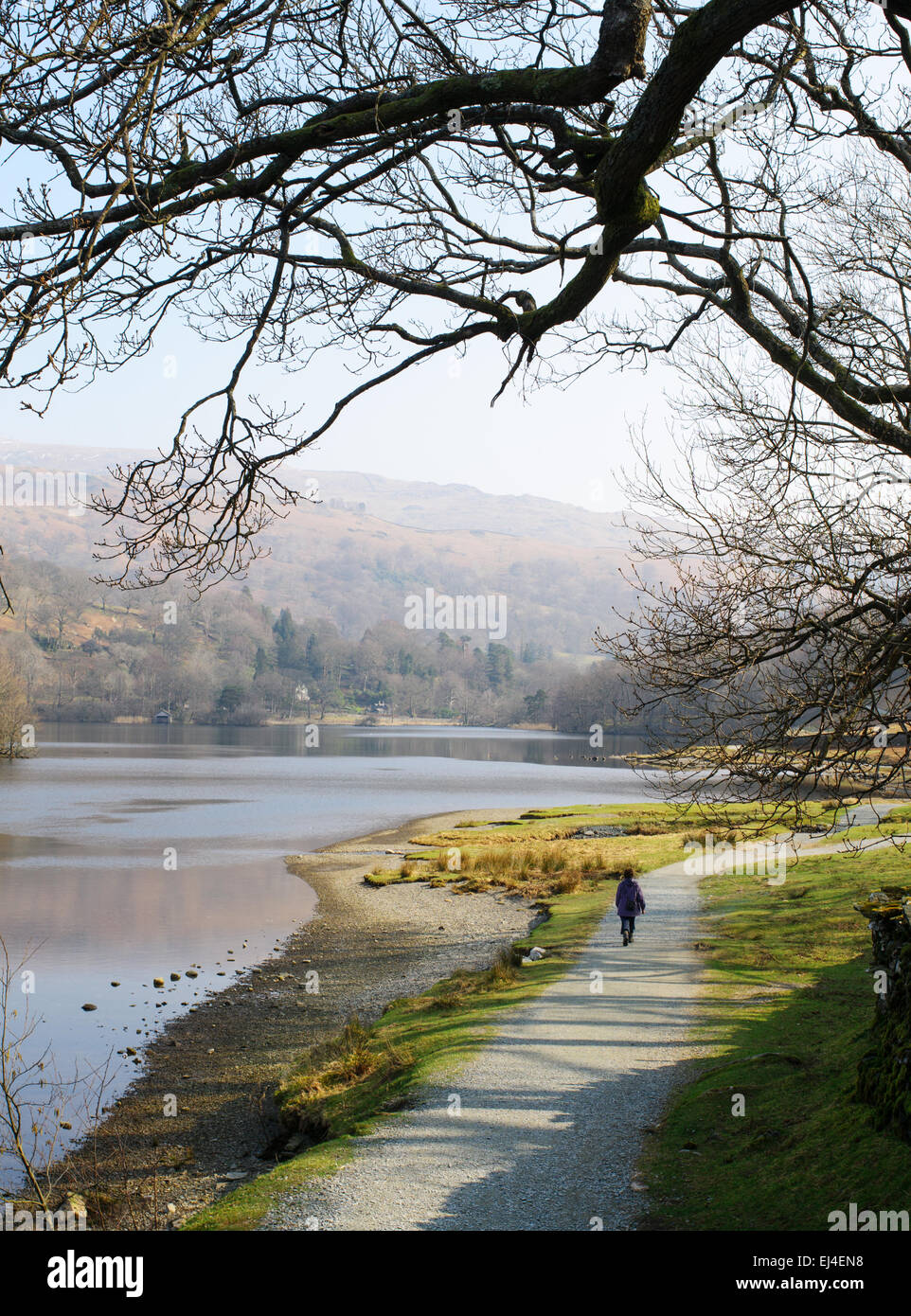 a-woman-walking-along-the-empty-lakeside