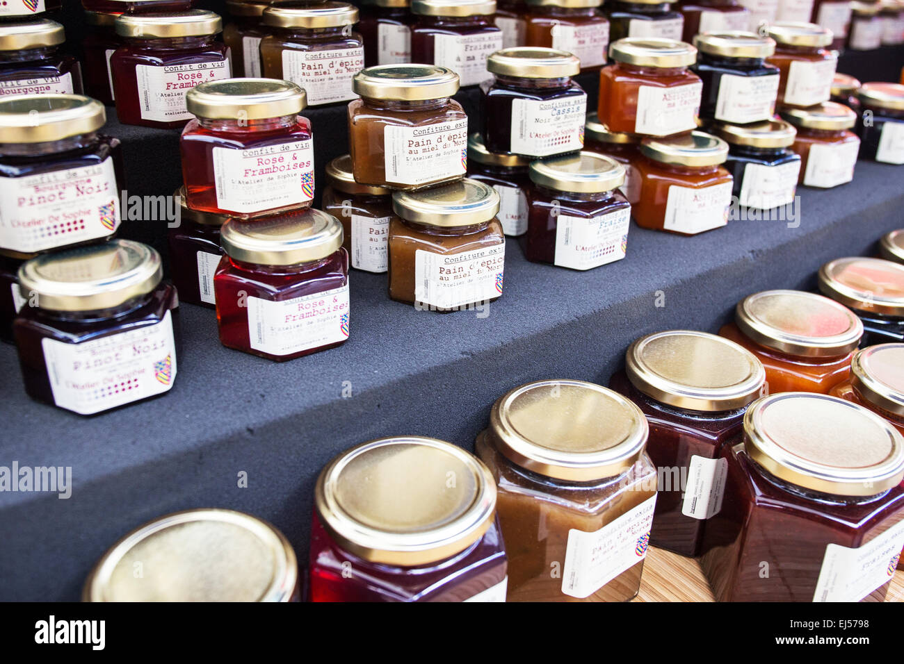 jars of jam and marmalade on sale at a farmers market in. Black Bedroom Furniture Sets. Home Design Ideas