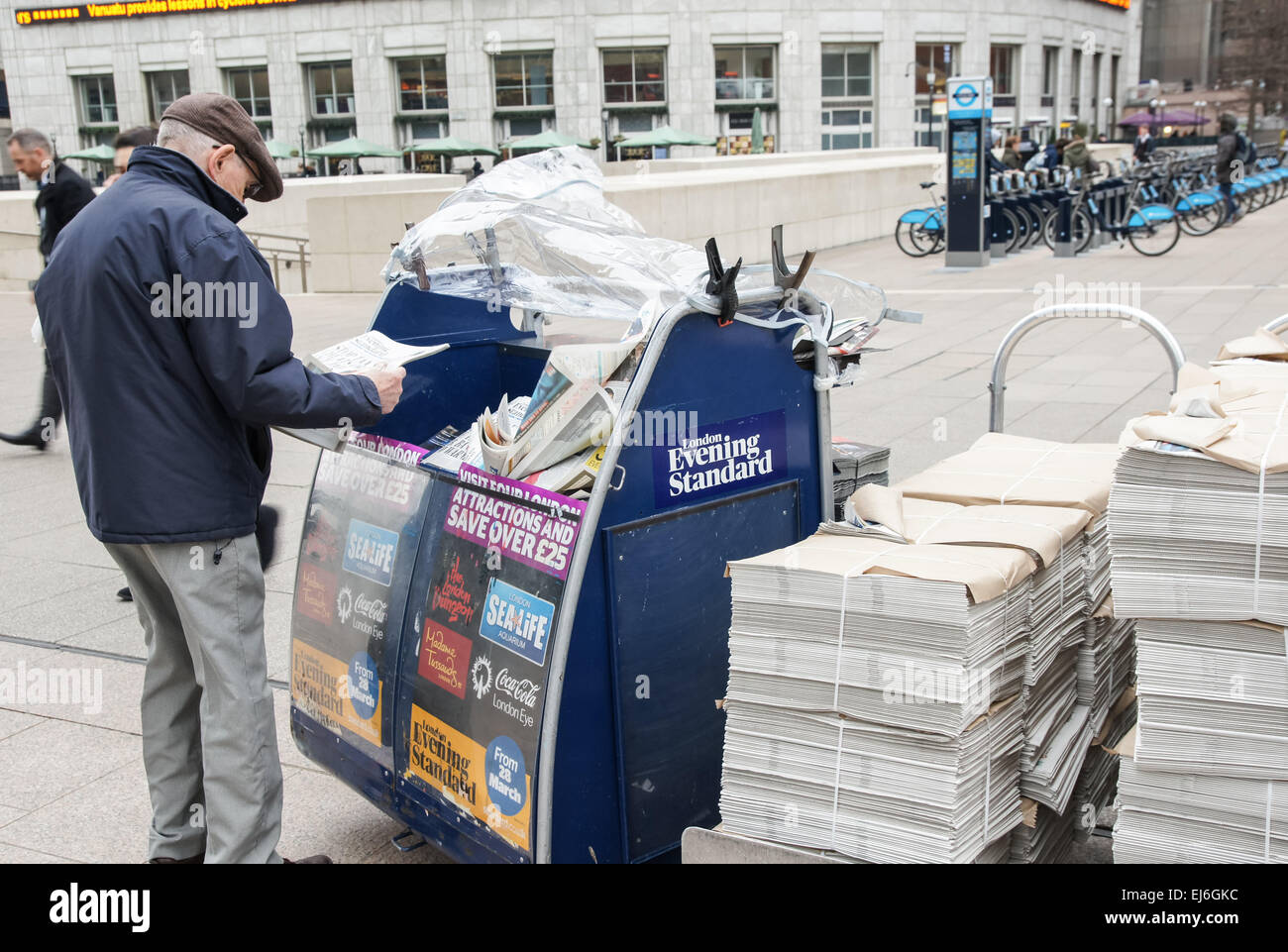 Evening Standard newspaper stand at Canary Wharf, London ...