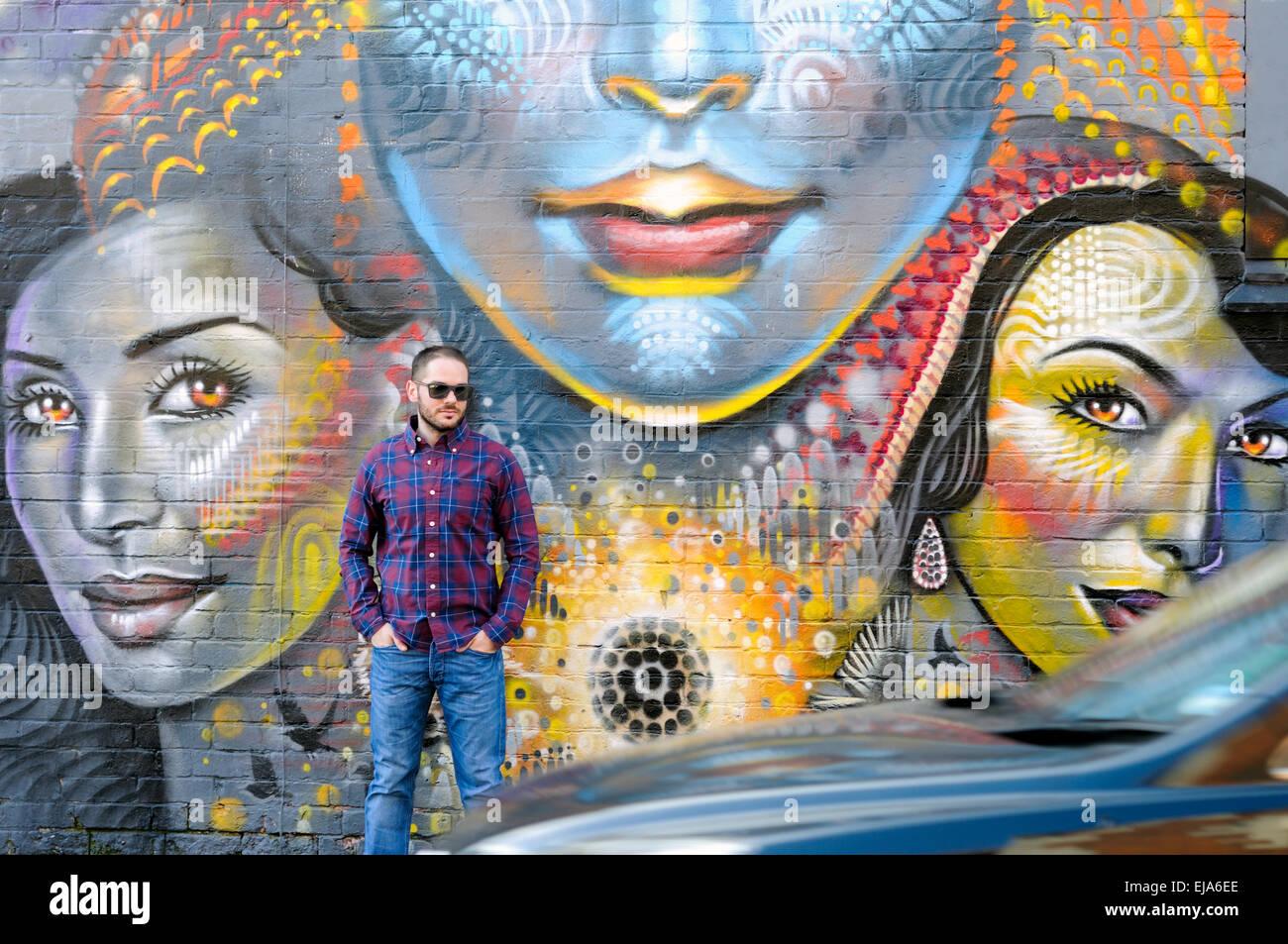 Graffiti wall uk - Leicester Man Standing Against Graffiti Wall Uk Stock Image