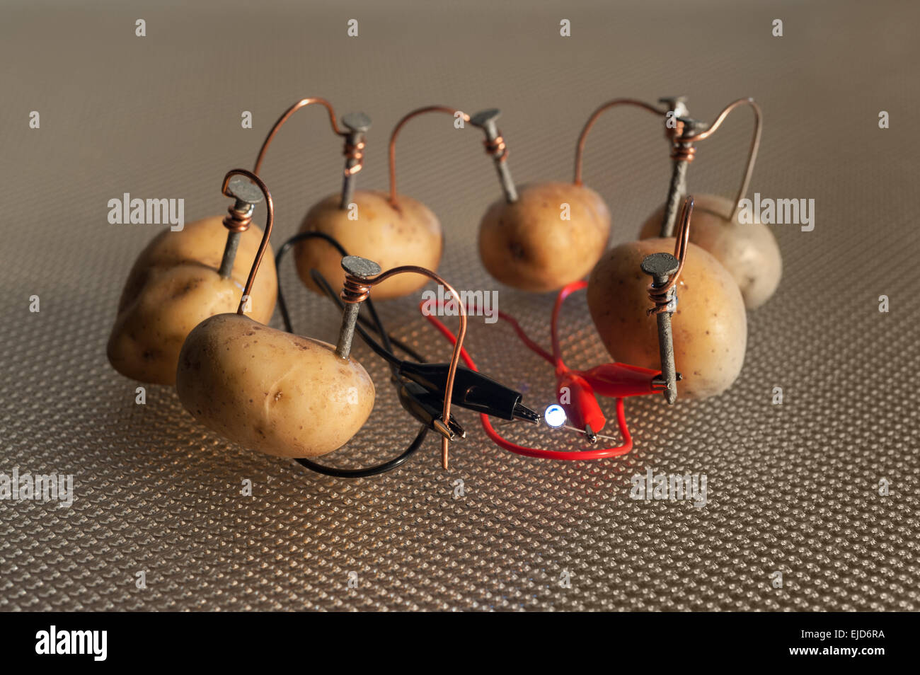 Alternative Energy Source Electrical Current Of Potato Arranged Is Series Provides Voltage To Light Led Bulb With Electrodes