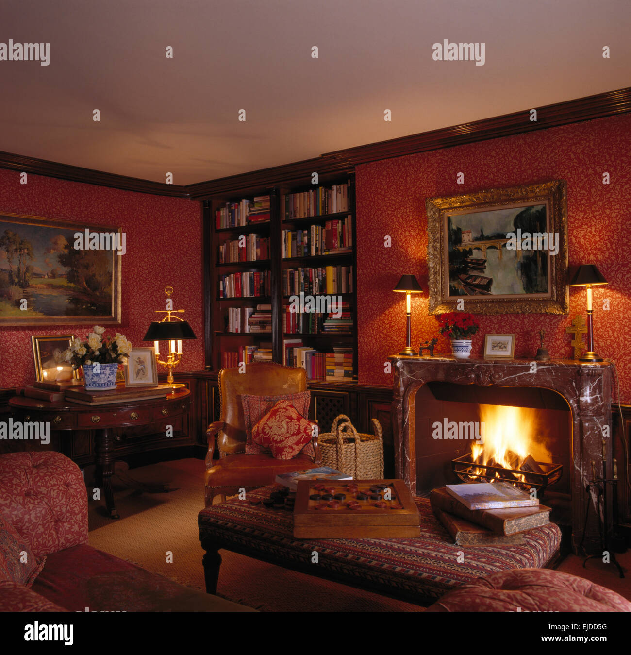 Lighted Fire In Fireplace Nineties Living Room With Red Wallpaper And Fitted Bookcase