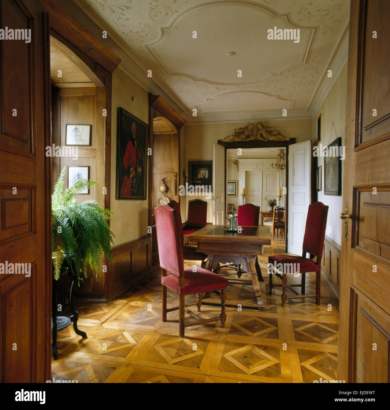 Parquet Flooring And Antique Dining Table Chairs In Period Hall Room
