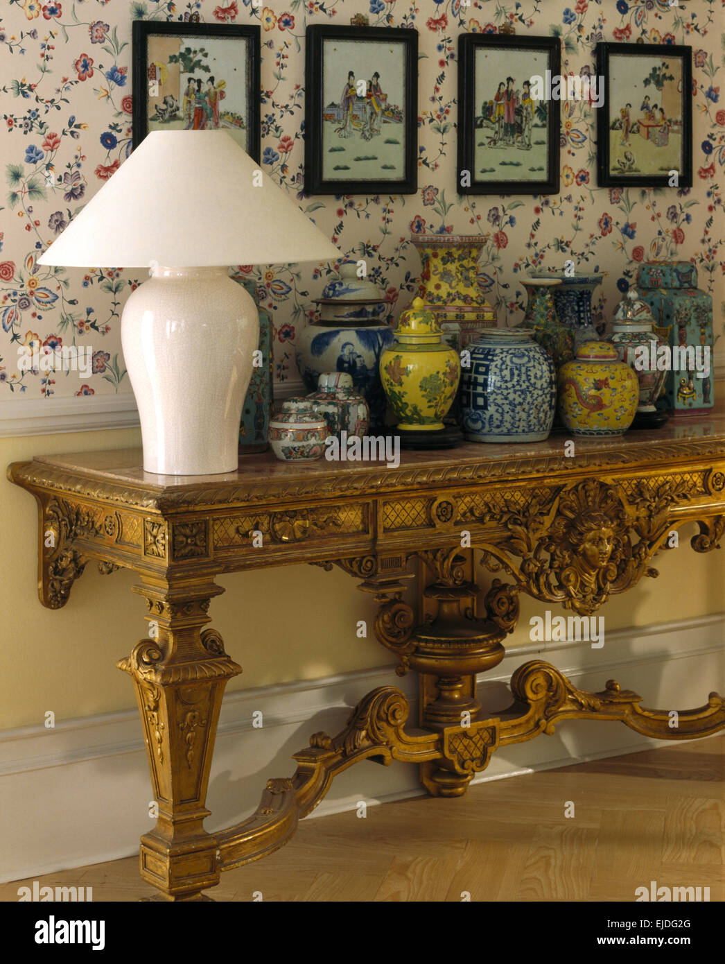 Collection of antique chinese vases on ornate gilt console table collection of antique chinese vases on ornate gilt console table geotapseo Gallery