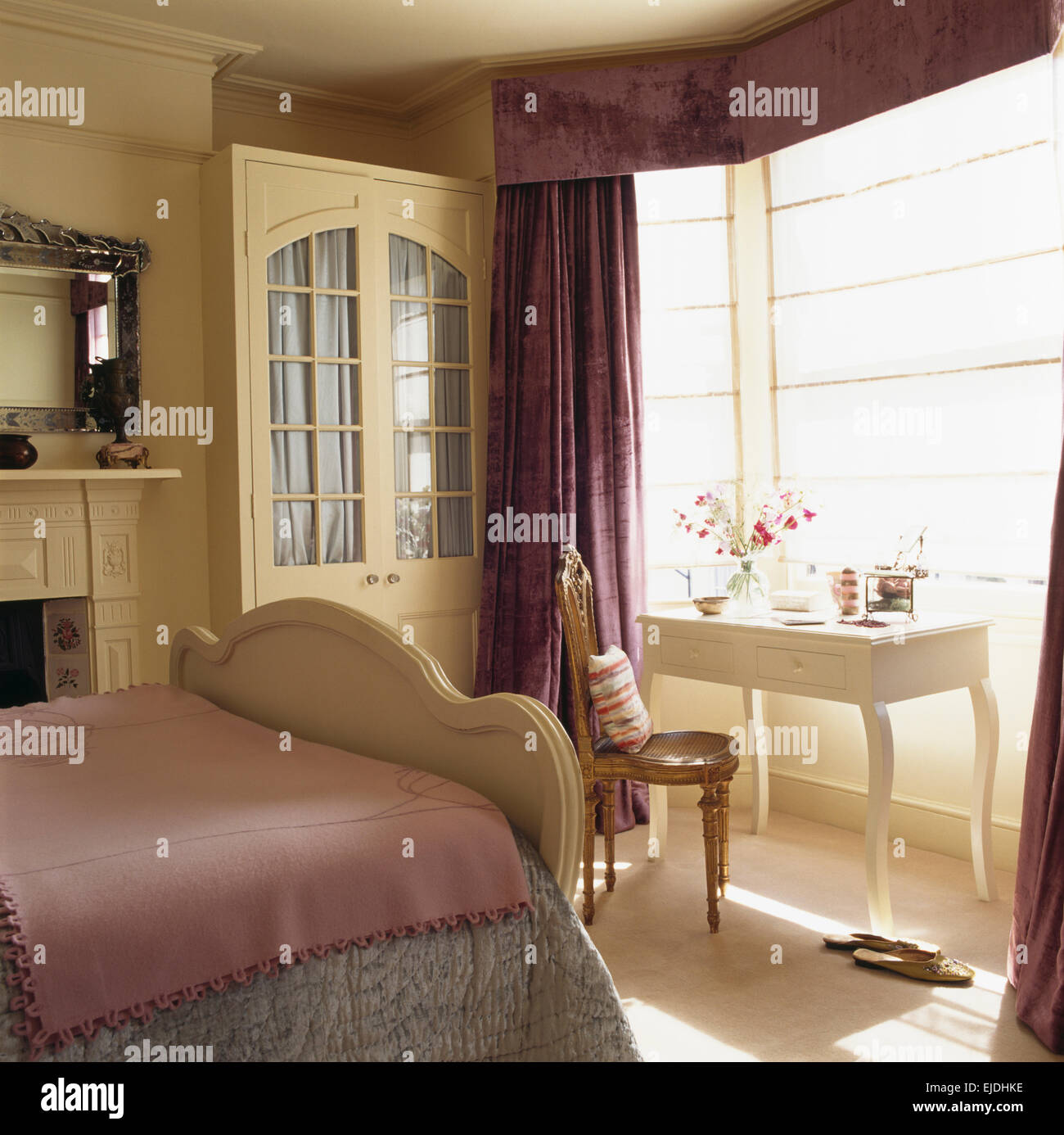 Bedroom ceiling drapes - Cream Fitted Wardrobe With Interior Drapes In Traditional Bedroom With Purple Curtains And Fine Linen Blinds
