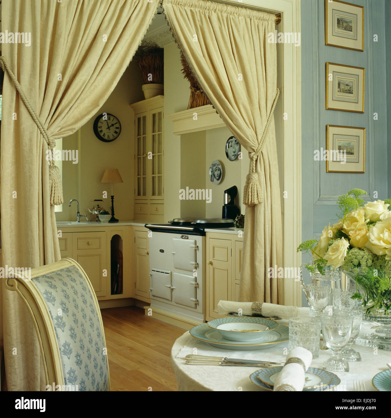 Table Set For Lunch In Small Blue Dining Room With Cream Curtains