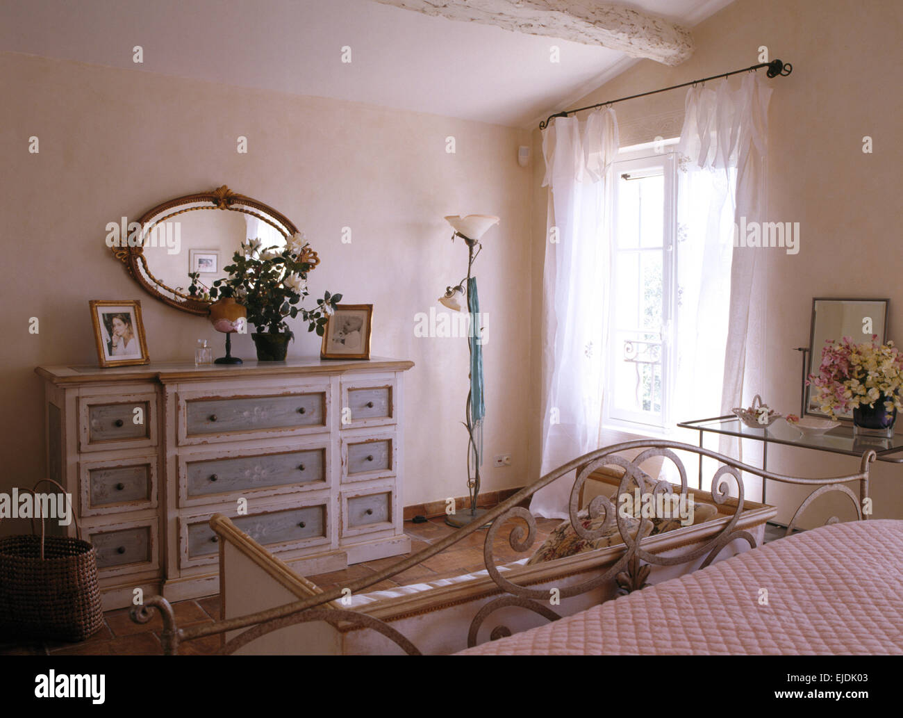 French country bedroom curtains - Oval Mirror Above Painted Chest Of Drawers In French Country Bedroom With White Voile Curtains On The Window