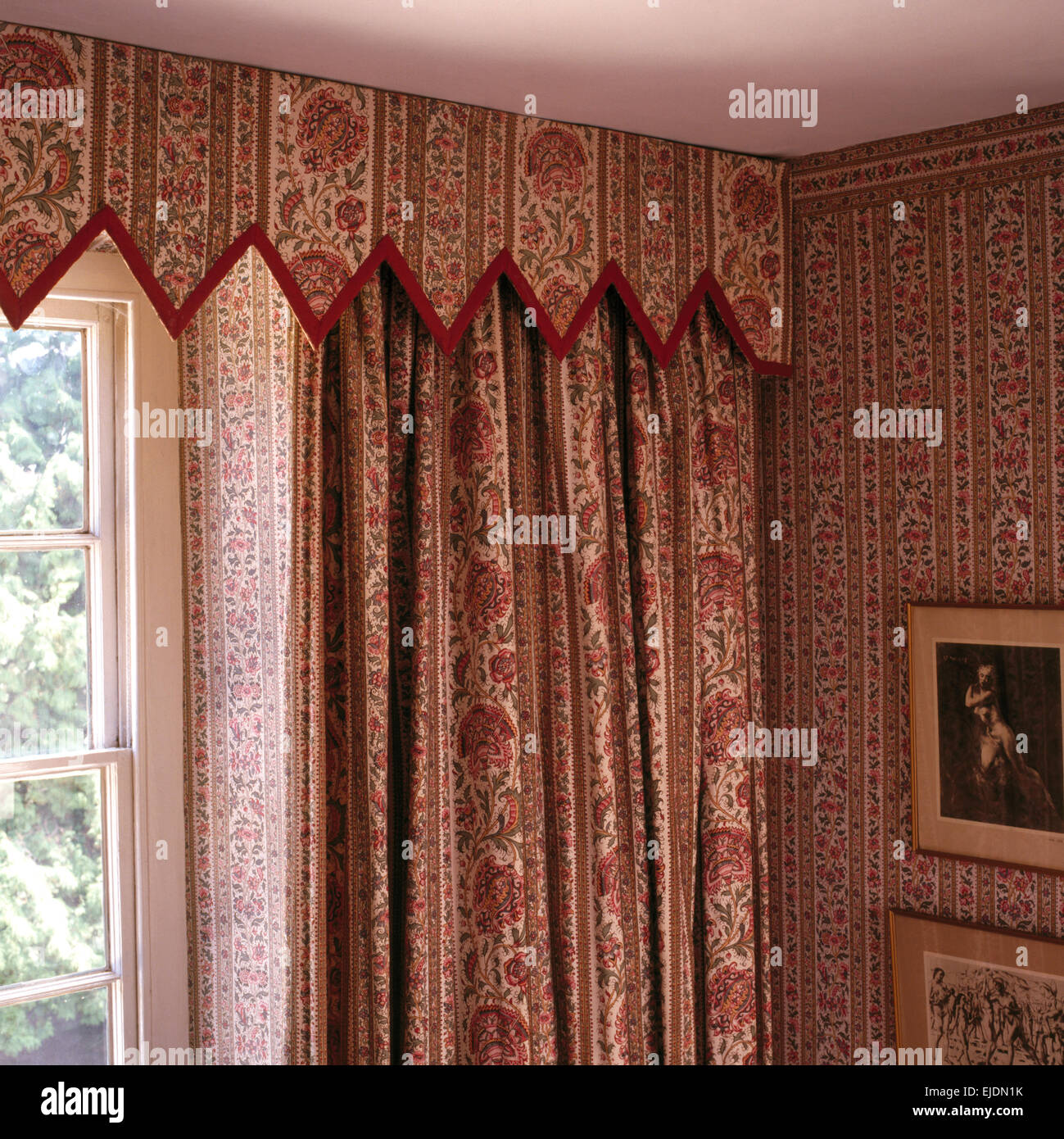 Close-up of patterned curtains and matching Gothic style pelmet and  wallpaper designed by Henrietta Spencer-Churchill