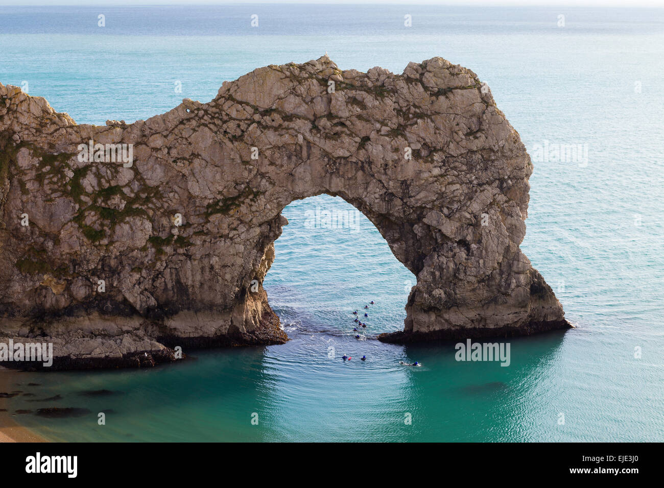 The Sea Arch At Durdle Door On The Jurassic Coast In Dorset On A Calm Sunny Day. Swimmers Swim Through The Arch & Durdle Door Arch u0026 Download Durdle Door Sea Arch Dorset Stock ... pezcame.com