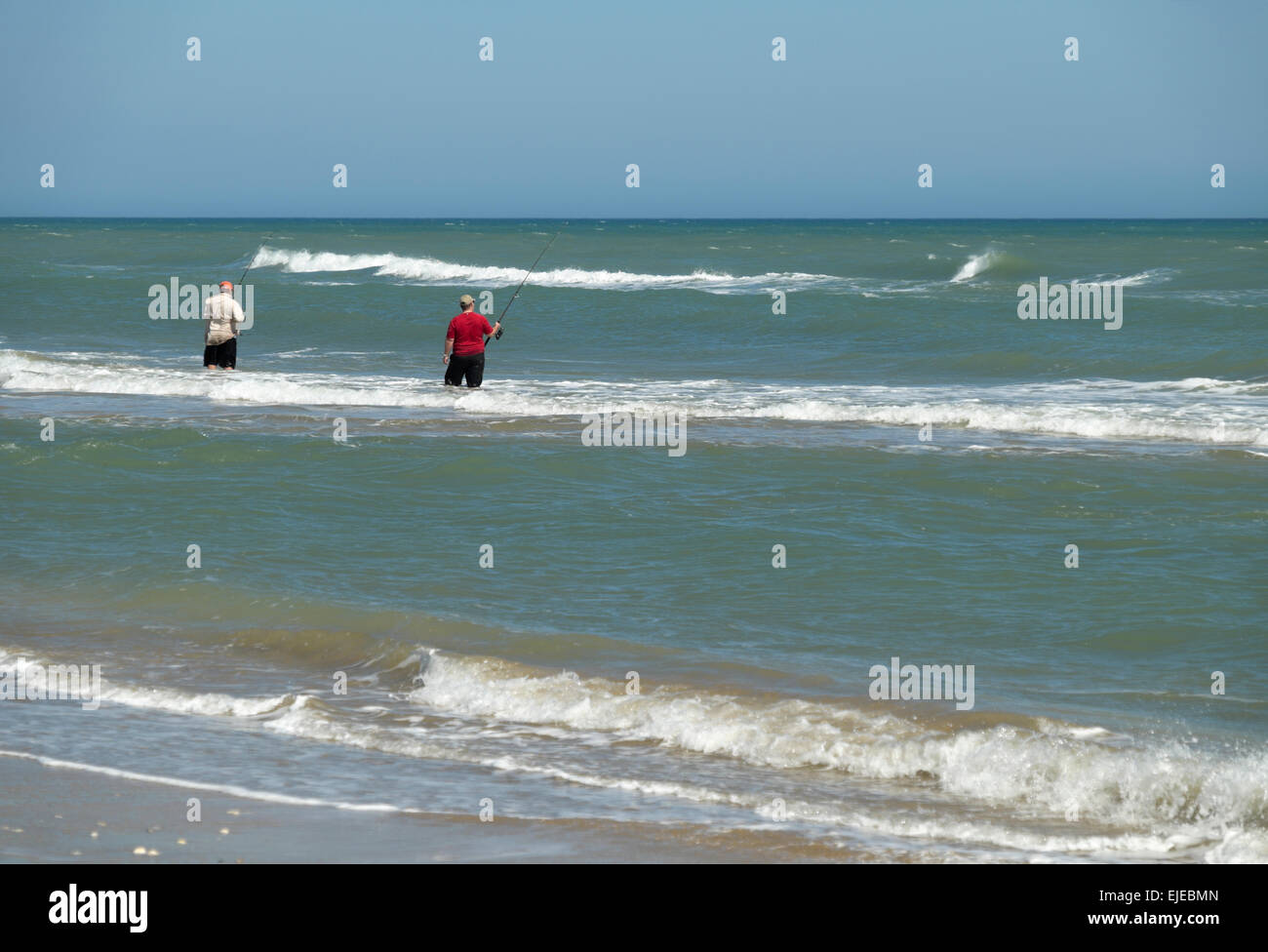 Two men surf fishing in february at south padre island for South texas fishing