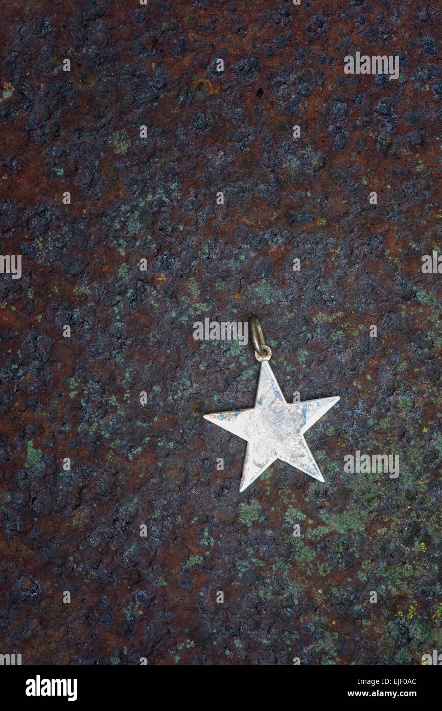 Star shaped pendant on rusted metal stock photo royalty free star shaped pendant on rusted metal mozeypictures Image collections