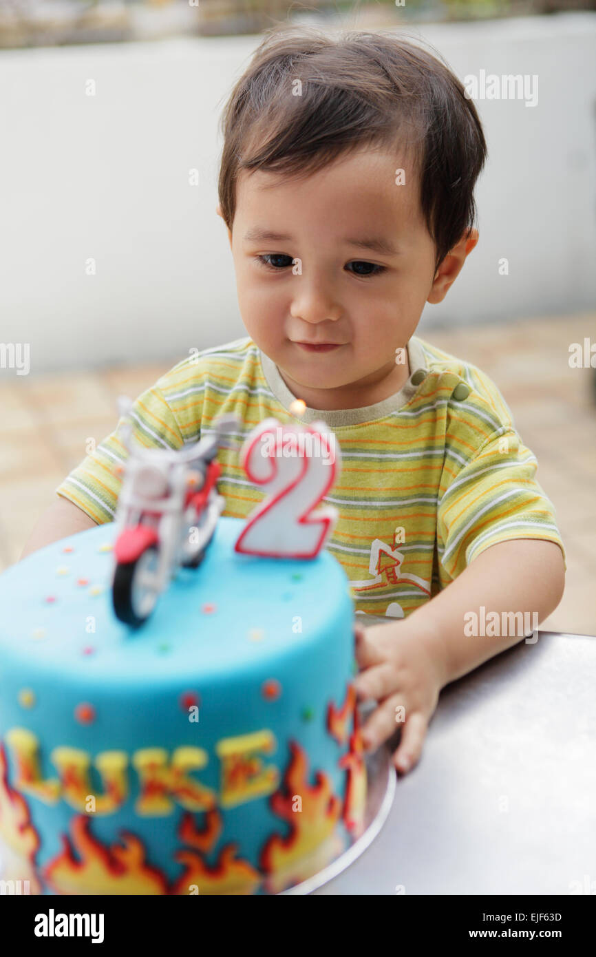 Baby Blowing Happy Birthday Cake