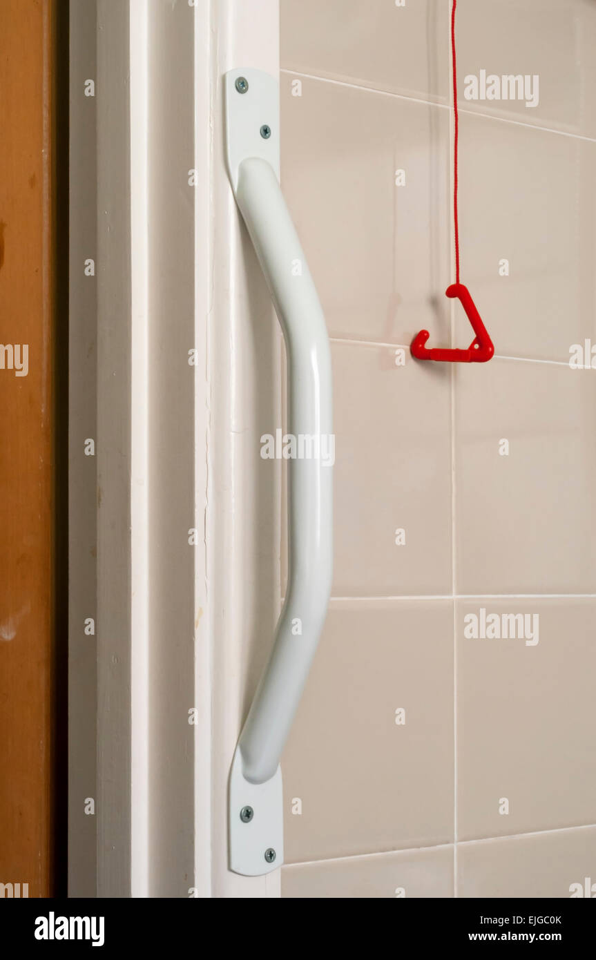 Grab Rail And Emergency Alarm Pull Cord In Bathroom Adapted For Use By An  Elderly Or Disabled Person.