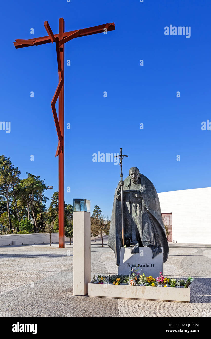 Sanctuary of fatima portugal statue of pope john paul ii with the statue of pope john paul ii with the high cross and basilica of most holy trinity in background buycottarizona Choice Image