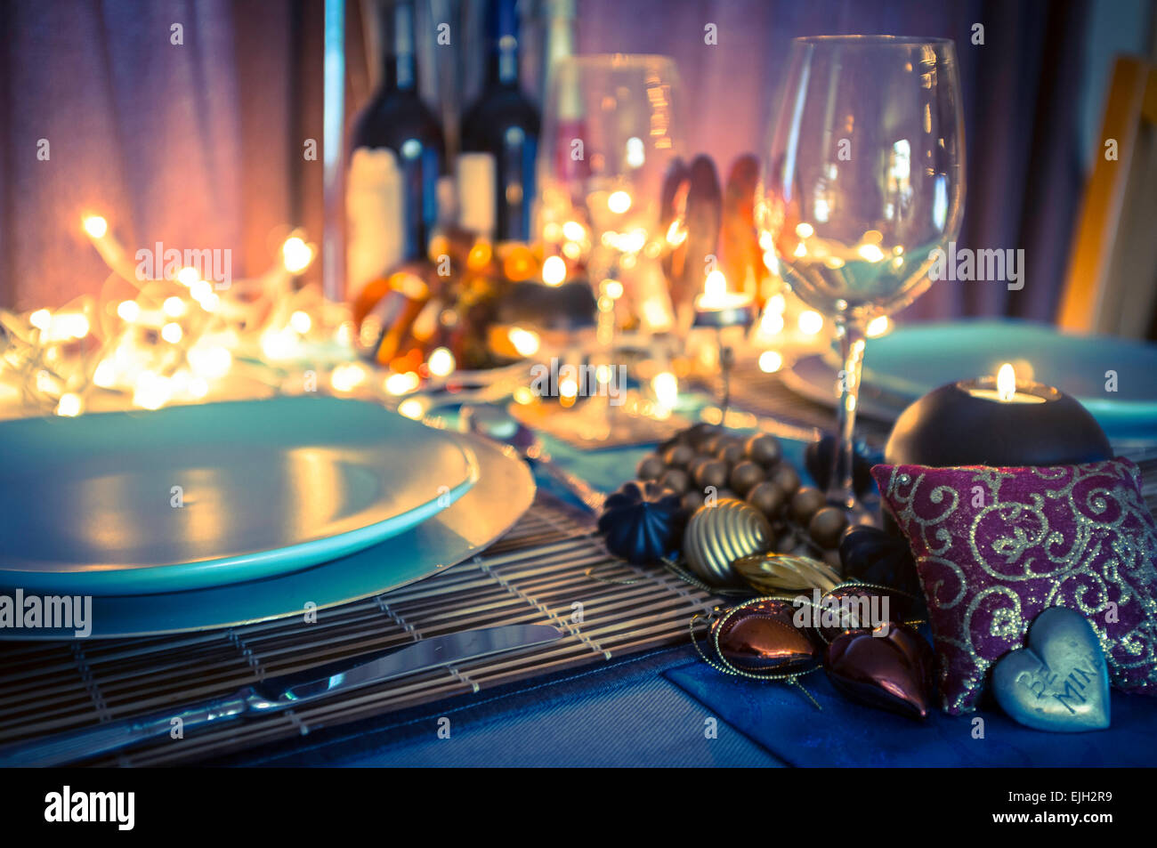 Romantic Decorations table setting and decorations for romantic dinner with candles
