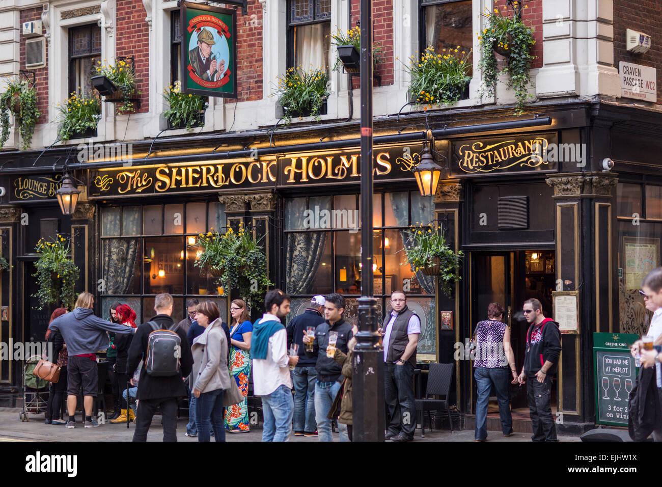 crowd drinking in street outside the sherlock holmes pub