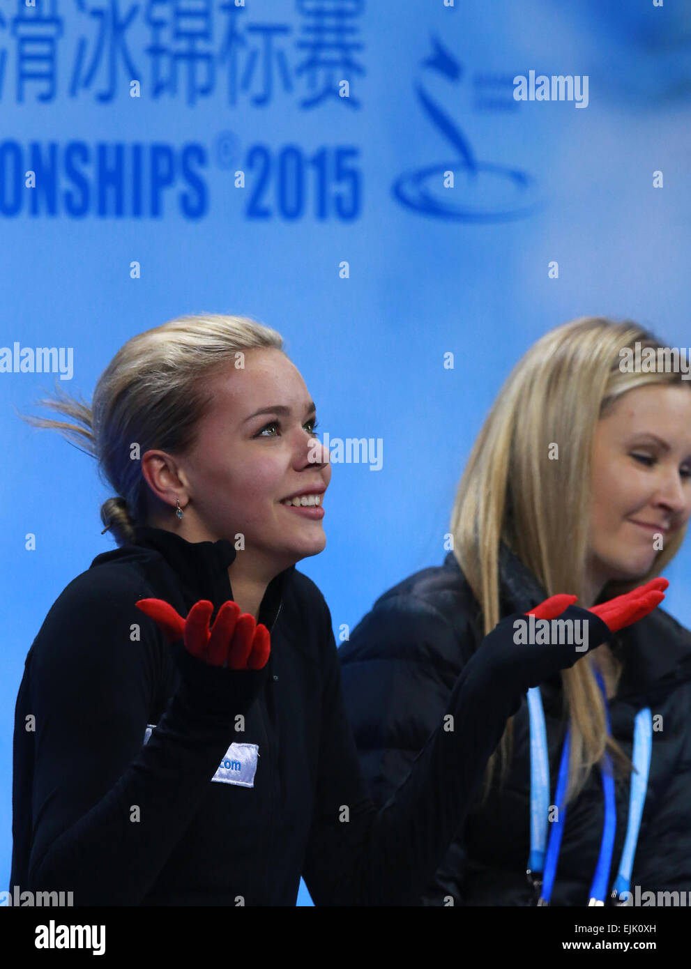 Shanghai, China. 28th Mar, 2015. Anna Pogorilaya of Russia (L) with her coach Anna Tsareva waiting for the scores in the kiss and cry after the ladies free skating event at the 2015 ISU World Figure Skating Championships at the Shanghai Oriental Sports Centre. Credit:  Vladimir Smirnov/TASS/Alamy Live News