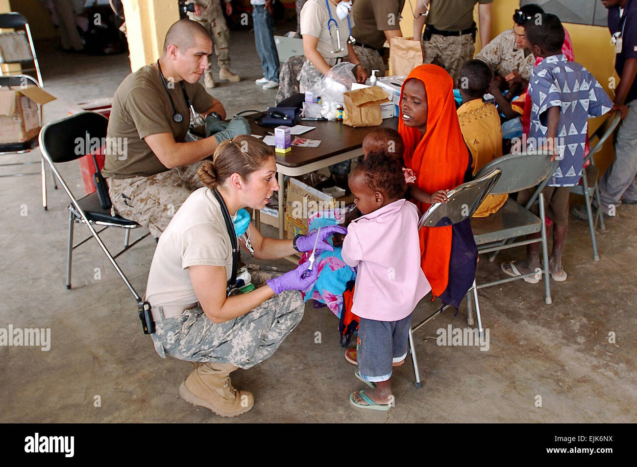 U.S. Army Sgt. Catherine Olivarez takes a boy's temperature during ...