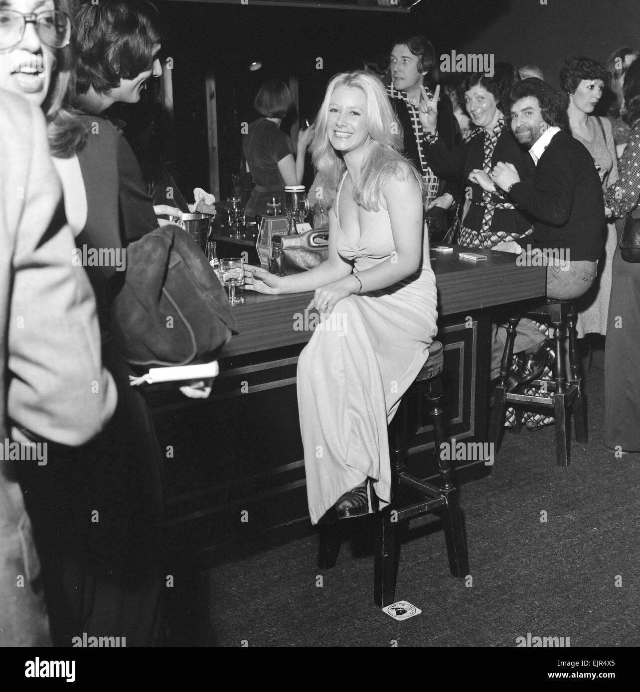 A Girl Sitting Alone At The Bar Inside The Nightclub Slack