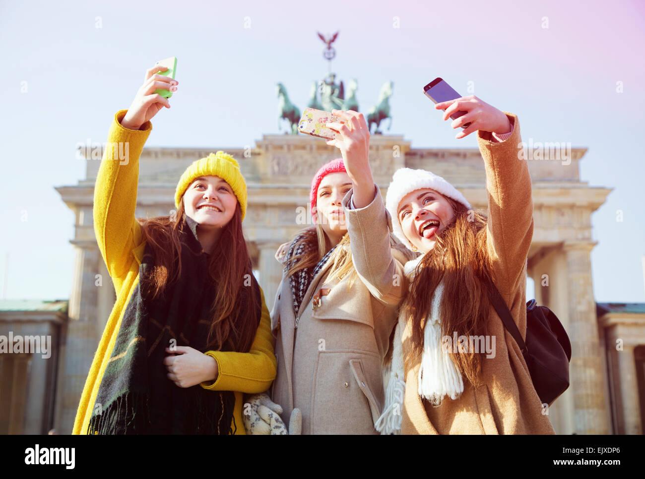 teenage-girls-taking-selfie-in-front-of-