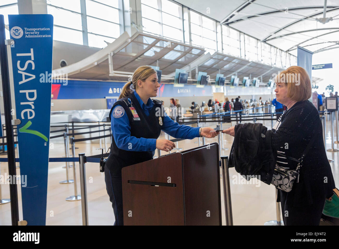 romulus michigan a transportation security administration officer checks the identity of passengers at detroit metro airport - Transportation Security Officer