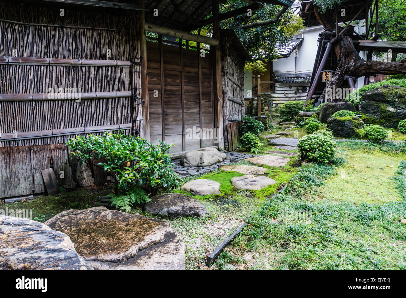 Charming Stock Photo   View Of A Traditional Japanese Garden With Old Bamboo Fence  And Stone Path In Kyoto, Japan
