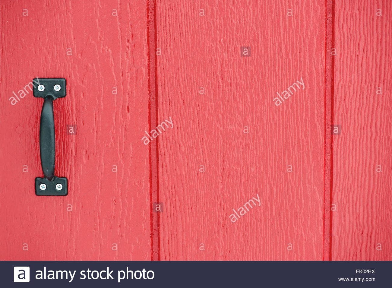 Red Barn Background rustic red barn door background with black handle stock photo